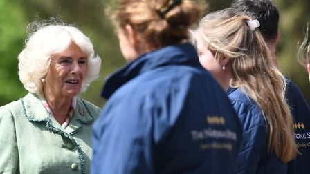 The Duchess of Cornwall meets staff from the foaling unit during a visit to the National Stud in New