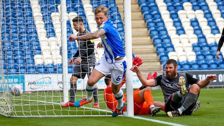 Frankie Kent wheels away after scoring the only goal in Colchester United's 1-0 home victory over Li