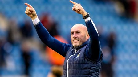 U's boss John McGreal celebrates his side's 1-0 home victory over tomorrow's hosts Lincoln City, fro