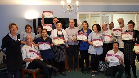 Staff at Haughgate House celebrating their report Picture: HEALTHCARE HOMES