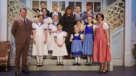 Debbie Turner with both sets of von Trapp children and Nic Metcalfe as Captain Georg von Trapp and K