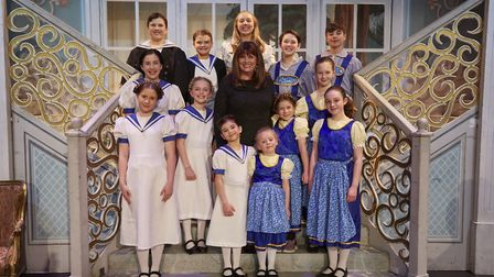 Debbie Turner with both sets of child actors for The Sound of Music at the Theatre Royal in Bury St