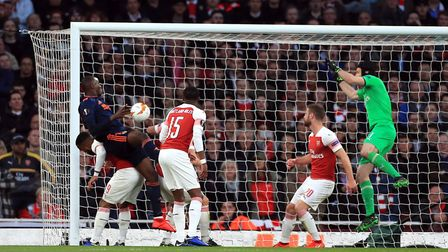 Valencia's Mouctar Diakhaby (second left) scores his side's goal against Arsenal on Thursday night.