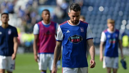 Cole Skuse and his Town team-mates leaves the pitch after their humbling at Preston. Picture: PAGEPI
