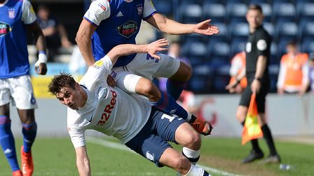 Myles Kenlock is caught by a late challenge from Ryan Ledson at Preston. Picture Pagepix