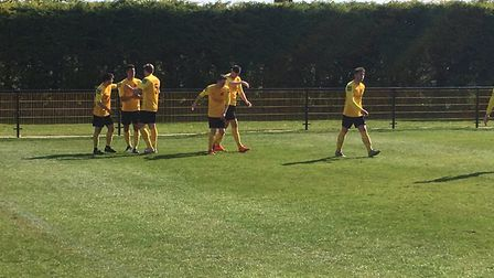 Mildenhall Town players celebrate Tom Debenham's 38th minute goal, which gave them the lead against