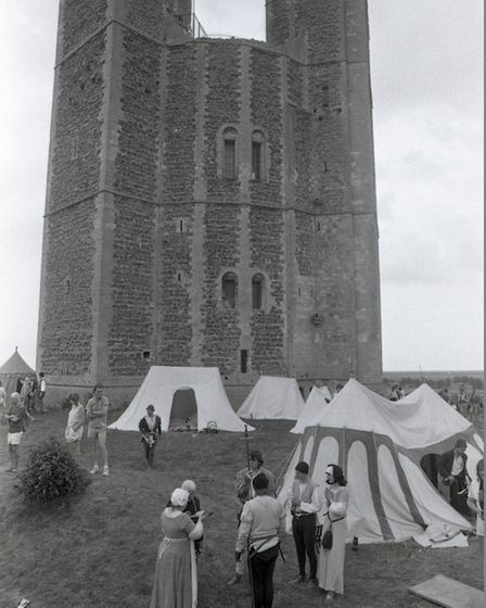 View of Orford castle in 1991 on a re-enactment day with the activity tents in the foreground Pictu