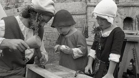 Children learn historical wood work skills in traditional dress, at Orford Castle Picture;OWEN HINE