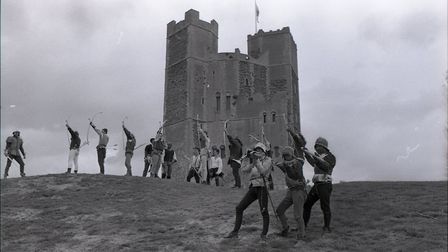 Shot of the re-enactors with Orford Castle in the background Picture: OWEN HINES