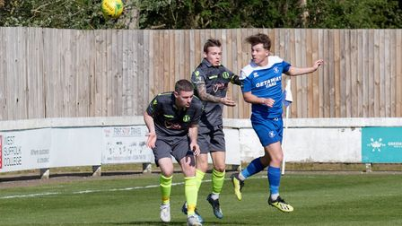 Jake Chambers Shaw heads Bury Town into a 2-1 lead against Grays. Picture: PAUL VOLLER