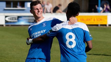 Ryan Jolland congratulates Emmanuel Machaya on his two-goal haul for Bury Town. Picture: PAUL VOLLER