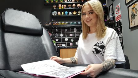 Molly Garnham is offering to do a free tattoo a month to someone who wants to cover up their self