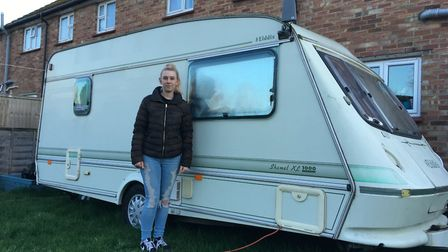 Kylie Goodyear, pictured beside the caravan where her family have been living Picture: ANDREW HIRST
