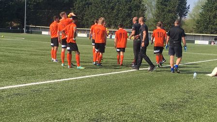 Bury Town players enjoy a drinks break, after going 2-0 up at AFC Sudbury. Picture: CARL MARSTON