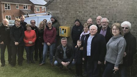 Residents from the Ballingdon estate in Sudbury who have donated £50 each to buy a defibrillator for