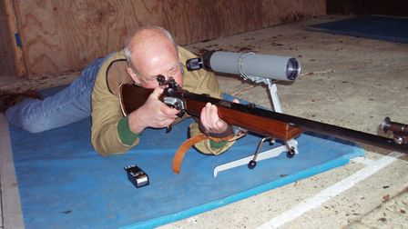 Stowmarket and District Rifle Club chairman Keith Cooper with a .22 rifle. Pictures: KEITH COOPER