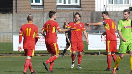 Jamie Griffiths celebrates with team-mates after netting Needham Market's second in a 2-0 win at Bar