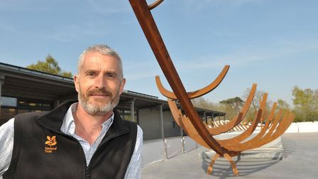 Nick Collinson with the new sculpture Picture: SARAH LUCY BROWN