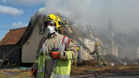 Suffolk fire crews tackling a huge thatch fire at The Ship Inn in Church Lane, Levington Picture: S