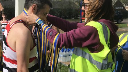 Runners are presented with their medals at the Sudbury Fun Run 2019