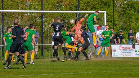 Woodbridge Town and Newmarket Town battle in a goalmouth scramble. Picture: PAUL LEECH