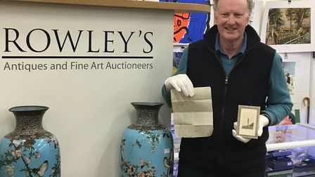 Auctioneer Roddy Lloyd, from Rowleys auction house, with the photo of Du Marurier and and the unseen