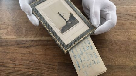 The poems were written on a neatly folded A14 piece of paper tucked behind the photo frame Picture: