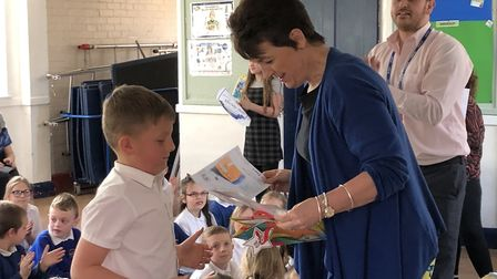 Bury St Edmunds MP Jo Churchill handing out awards at Crawford's CE Primary School in Haughley. Pict