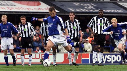 Marcus Stewart scores from the penalty spot against Newcastle in April 2001