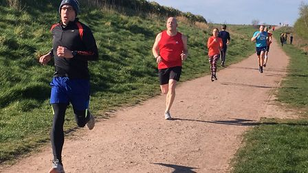 Runners from a 100-plus field approach the finish to last Saturday's Frickley Country parkrun, in We
