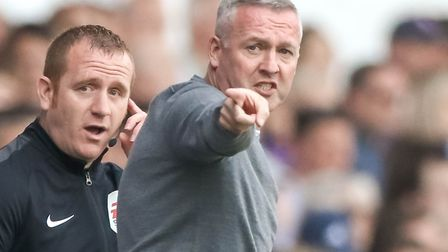 Town manager Paul Lambert makes a point to the fourth official in the first half. Picture: STEVE