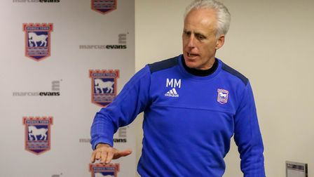 Town manager Mick McCarthy bangs the desk in the media room as he announces that he has quit the clu