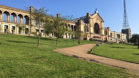 Alexandra Palace, often known as 'The People's Palace' and nicknamed 'Ally Pally,' overlooks a parkr