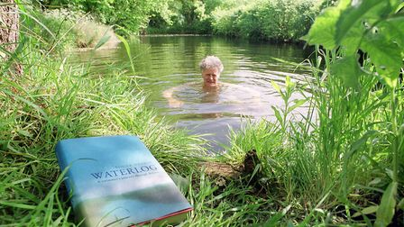 The late Roger Deakin swimming in a moat at his home in Mellis, Suffolk PIC: Owen Hineseadt