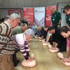 The group learn how to do chest compressions at a session in Stowmarket Picture: NIGEL DONKIN