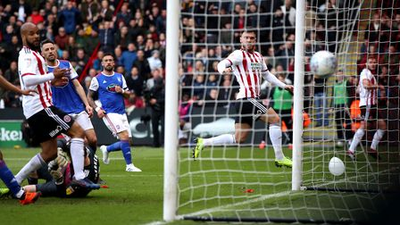 Sheffield United's Scott Hogan (centre right) scores his side's first goal of the game. Picture: PA