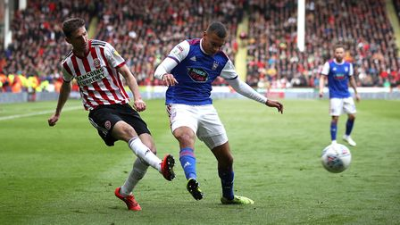 Sheffield United's Chris Basham (left) and Ipswich Town's Myles Kenlock (right) battle for the ball.