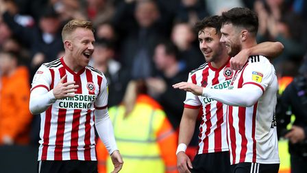 Sheffield United's Scott Hogan (right) celebrates scoring his side's first goal of the game. Picture