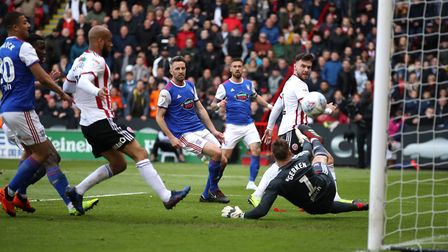 Sheffield United's Scott Hogan scores his side's first goal of the game. Picture: PA