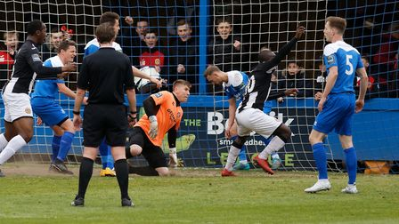 Evans Kouassi turns in celebration after scoring the winning goal for Heybridge at Bury. Picture: PA