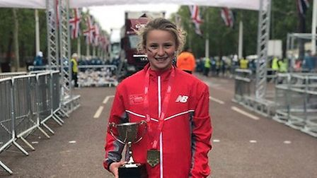 Ruby Vinton with her winner's trophy at the finish of the London Mini Marathon, on The Mall.