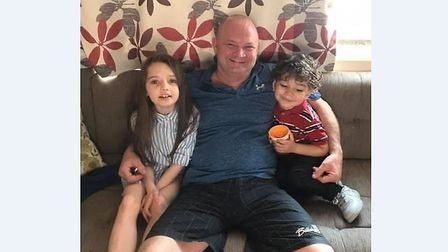Paul Knight, 51, from Liverpool, with his grandchildren Grace and Max Picture: SUPPLIED BY FAMILY