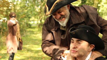 Geir Madland (Dick Turpin) threatens Quinn Richards (Thomas Easter) while Hayley Evenet (Lady Elizab