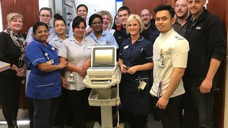 Staff from F7 and Sealeys at West Suffolk Hospital with the ECG machine Picture: MY WISH CHARITY