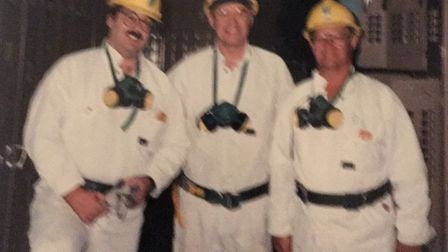 Slightly blurry, but Ray Woodhouse is the man in the middle during a visit to a mine at Mount Isa, Q