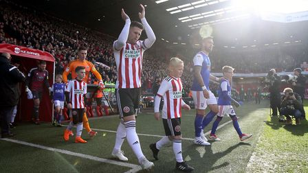 Sheffield United's Oliver Norwood leads the team out onto the pitch . Picture: PA