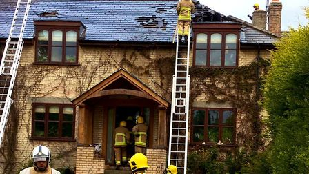 Firefighters attempted to put out flames in the loft space of a detached two-storey building Picture