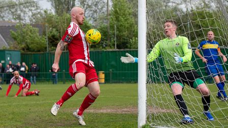 Seasiders' Darren Mills (foreground) restored some hope in the 69th minute; bundling in the ball wit