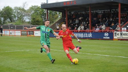 Needham's Adam Mills looks to play a cross into the box. Picture: BEN POOLEY