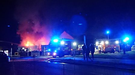 Fire crews were called to the scene of a large blaze at a builder's yard in Oulton Picture: SUFFOLK